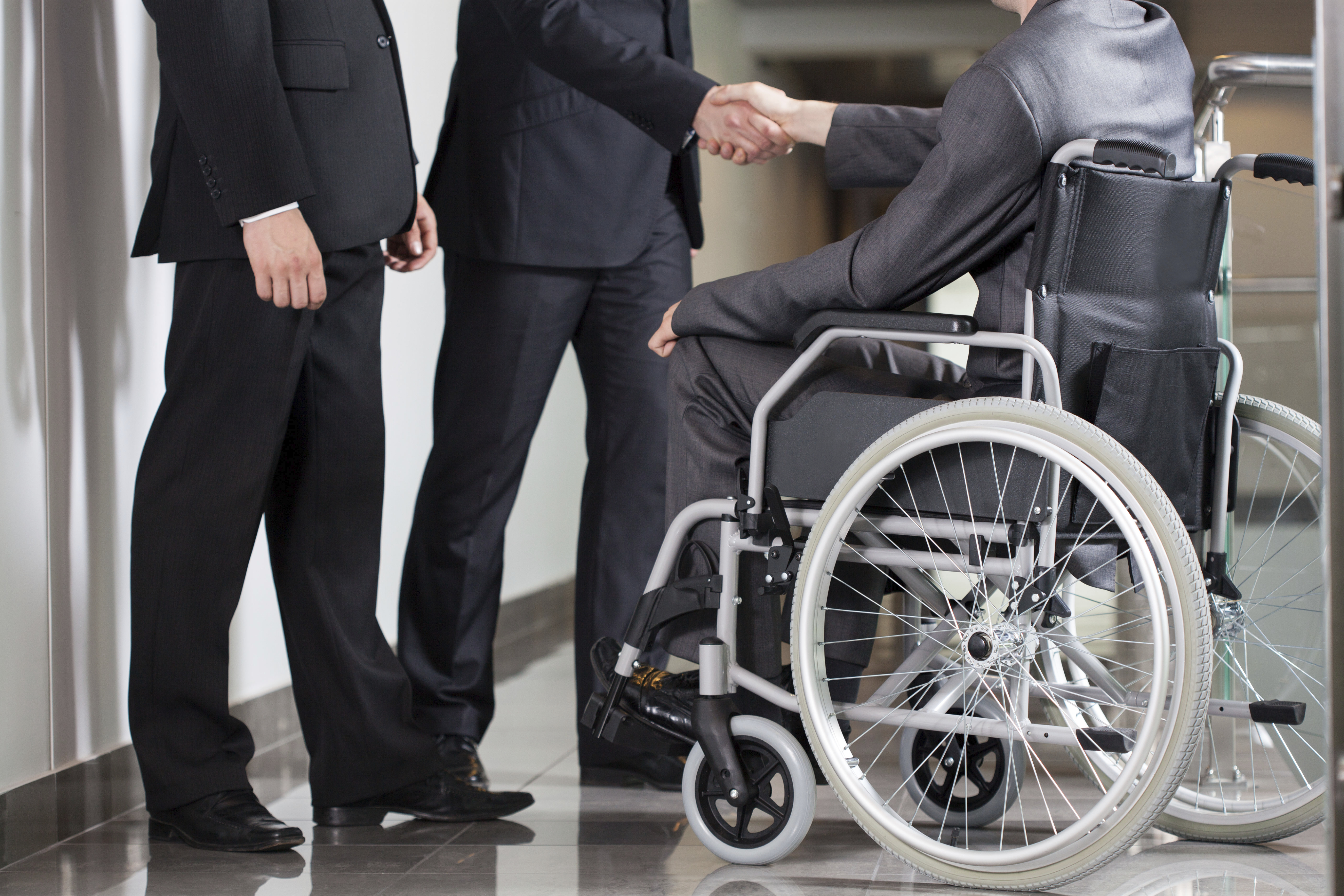 Man Greeting in Wheel Chair